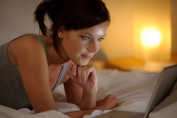 Bedroom evening - woman with laptop