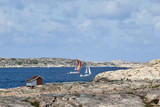 Sailboats at rocky coast