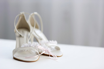 Elegant bridal shoes and a garter