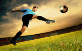 Happiness football player on field of olimpic stadium on sunrise