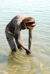 Washing off Dead Sea Mud