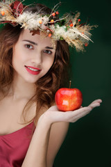 young smiling girl with apple