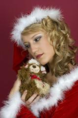 Sexy Frau in Santa Klaus  Bekleidung und Teddy