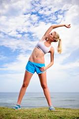 Blond girl exercises