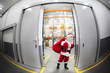 Santa Claus with red sack leaving storehouse full of presents