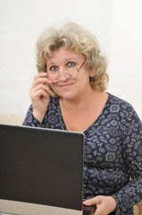 middle-aged woman with a laptop