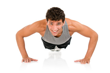 Happy man doing push ups