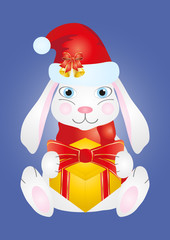 cute smiling rabbit in Christmas cap holding a gift
