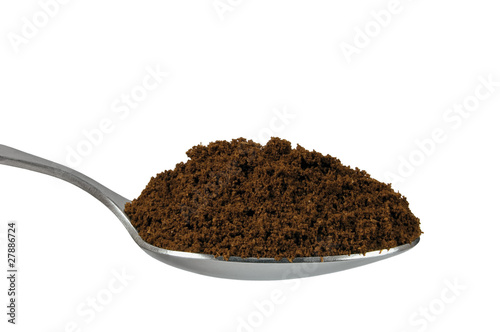 Spoonful of fine ground medium roasted Arabica coffee for espres