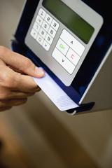 Hand scanning card through machine