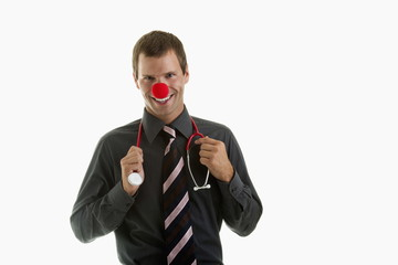 Doctor with stethoscope and clown's nose