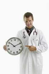 Doctor holding clock showing time