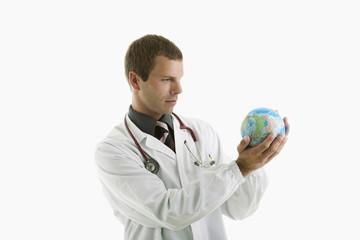 Doctor examining a globe