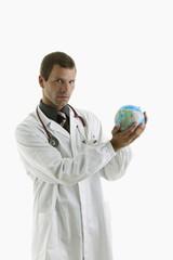 Doctor holding globe