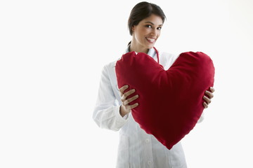Doctor holding heart pillow