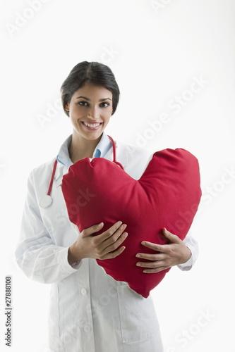 Doctor holding heart pillow