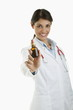 Doctor holding medicine bottle