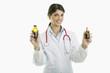 Doctor holding medicine bottles