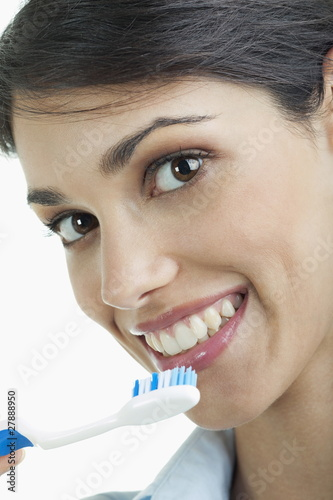 Young woman holding toothbrush