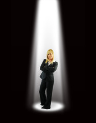 Business woman under spotlight