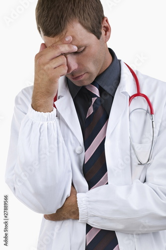 Worried doctor with hand on his head