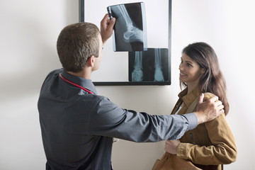 Doctor showing Xray to patient