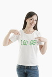 Young woman wearing 'I go green' tshirt