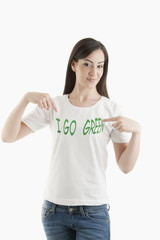 Young woman wearing 'I go green' tshirt