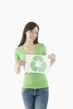 Young woman holding recycling symbol drawing