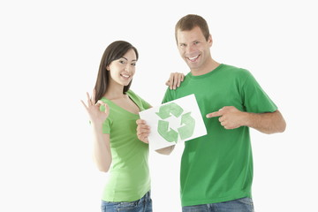 Couple holding recycling symbol drawing