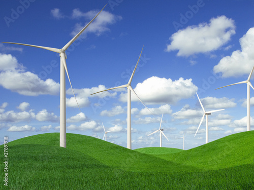 Wind turbines in rolling landscape of green grass