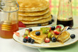 pancakes with maple syrup,honey and berries