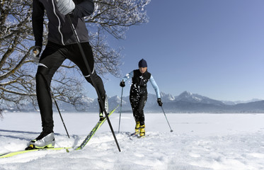 Mid adult couple cross-country skiing in Allgau,  Bavaria,  Germany