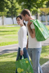 Couple with reusable shopping bags