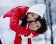 Portrait of young happy couple hugging on winter day