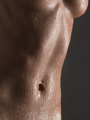 Close-up of wet nude woman, studio shot