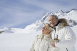 Senior couple in coats on winter day in the mountains