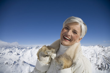 Portrait of mature woman in mountains on winter day