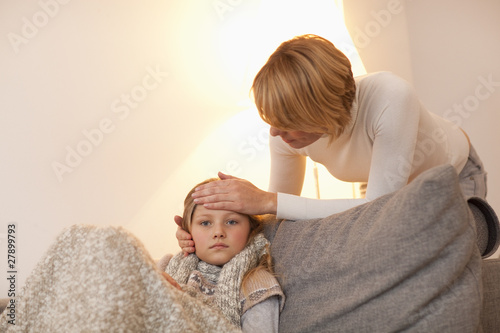 Mother checking daughter's temperature