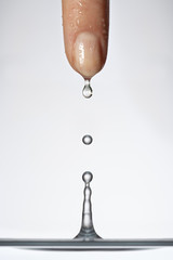 Water dripping from a woman's finger