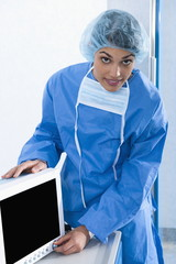 Surgeon adjusting monitor in operating room