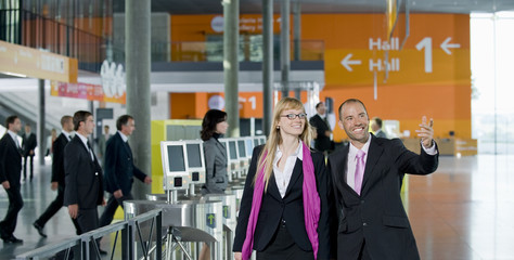 Two businesspeople in the foyer of a conference centre