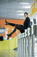 A woman jumping over a ticket barrier