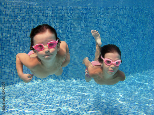 Two underwater girls in swimming pool