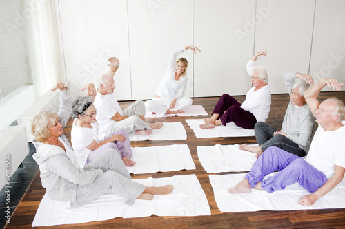 A group of seniors stretching in an exercise class