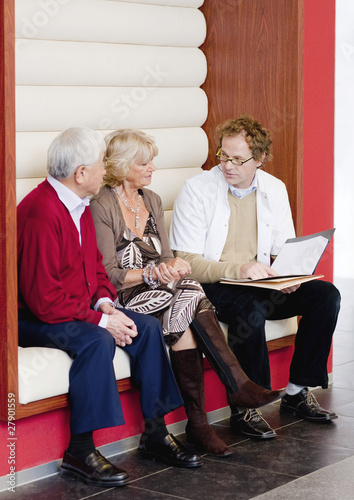 A senior couple talking to a medical consultant