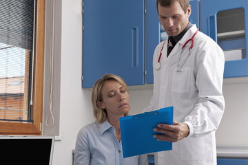 Doctor and patient discussing medical chart