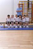 School children and teacher in school gymnasium
