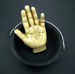 Palmistry hand in cauldron