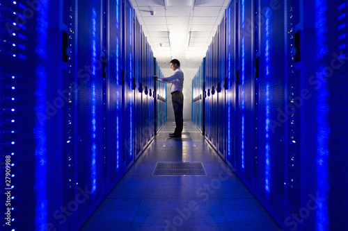 IT technician checking network server